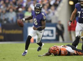 Baltimore Ravens QB Lamar Jackson eludes the Cincy Bengals defense, but he could not fade COVID-19. (Image: Nick Wass/AP)