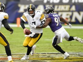 Ben Roethlisberger of the Pittsburgh Steelers evades a tackler in AFC North action. (Image: Nick Wass/AP)