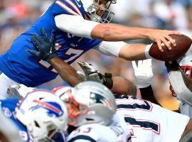 Buffalo Bills QB Josh Allen dives for a touchdown against New England. (Image: Adrian Kraus/AP)