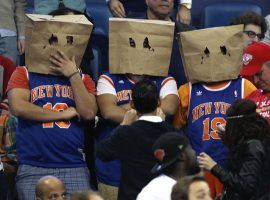 New York Knicks fans at Madison Square Garden embarrassed about their losing ways. (Image: Jonathan Bachman/AP)