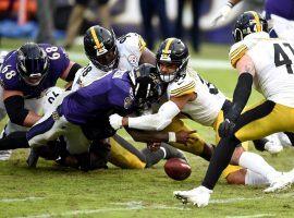 Baltimore Ravens QB Lamar Jackson gets stuffed by Pittsburgh Steelers LB Minkah Fitzpatrick. (Image: Gail Burton/AP)