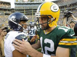 Quarterbacks Russell Wilson and Aaron Rodgers are MVP contenders this season. (Image: Mike Roemer/AP)
