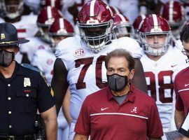 Alabama coach Nick Saban, who was infected with COVID-19 in October, will not lead his Crimson Tide into battle vs. LSU this weekend because of the pandemic. (Image: Getty)