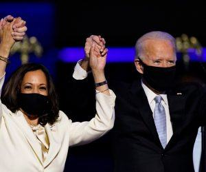 President-elect Joe Biden and vice president-elect Kamala Harris raise their hands in victory on Nov. 7. Some leading sportsbooks have yet to pay on the Biden win. (Image: AP)