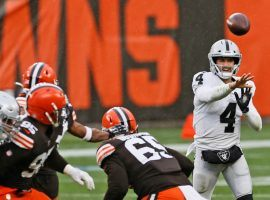 Raiders quarterback Derek Carr stuck with short passes in the wind at Cleveland, as that game was the only one in NFL Week 8 betting that hit the under. (Image: AP)