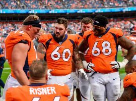 DENVER, CO - SEPTEMBER 15:  Connor McGovern #60 of the Denver Broncos talks to teammates on the offensive line, including Garett Bolles #72, Elijah Wilkinson #68, and Dalton Risner #66 as they sit in the bench area during a game against the Chicago Bears at Empower Field at Mile High on September 15, 2019 in Denver, Colorado. (Photo by Dustin Bradford/Getty Images)