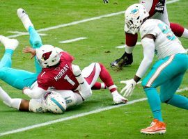 After a strip sack by Miami's Emmanuel Ogbah, teammate Shaq Lawson got the NFL Week 9 highlight by scooping up the loose ball and running in for a touchdown. (Image: CBS Sports)