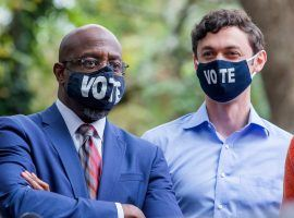 Oddsmakers believe Democratic candidates Raphael Warnock (left) and Jon Ossoff (right) are making gains in their Georgia Senate runoff races. (Image: Erik S. Lesser/EPA)