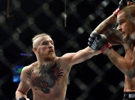 Conor McGregor (left) and Dustin Poirier (right) will meet up for a rematch in the main event of UFC 257 at Fight Island on Jan. 23. (Image: Jeff Bottari/Zuffa/Getty)