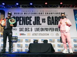 Errol Spence (left) will defend his welterweight titles on Saturday night against Danny Garcia (right). (Image: Ryan Hafey/Premier Boing Champions)
