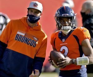 Spot starting Broncos quarterback Kendall Hinton who was pulled from the practice squad as the only possible option for Denver last weekend looks on from the sidelines. (Image: AP)