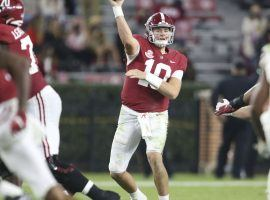 Mac Jones and Alabama are one of three teams who will have to cover large point spreads in College football Week 14 betting. (Image: USA Today Spam)