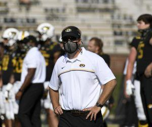 Missouri football canceled practice and pulled out of the Music City Bowl Sunday after an increase in positive COVID-19 tests. First-year head coach Eliah Drinkwitz.said team activities were on pause until Jan. 2 forcing the Tigers to pull out of the Music City Bowl vs. No. 15 Iowa set for Wednesday. (Image: AP)