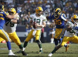 LA Rams DE Aaron Donald closes in on Green Bay Packers QB Aaron Rodgers in 2018. The Packers are favorites by almost a touchdown against the Rams in the NFC Divisional playoff round. (Image: Joe Robbins/Getty)