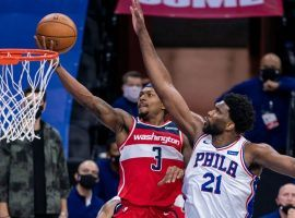 Bradley Beal of the Washington Wizards, seen here, drives to the basket against Joel Embiid of the Philadelphia 76ers. Beal scored a career-high 60 points. (Image: Getty)