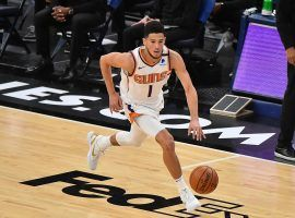 Devin Booker leading the Phoenix Suns in transition. The Suns host the Denver Nuggets with back-to-back games in Phoenix this weekend. (Image: Justin Ford/Getty)