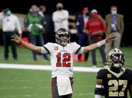 Tom Brady celebrates a touchdown for the Tampa Bay Bucs over the New Orleans Saints in the NFC divisional playoffs. Brady and the Bucs are one win away from the Super Bowl. (Image: Chris Graythen/Getty)