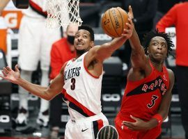 Portland Trail Blazers guard CJ McCollum, seen here driving by Toronto's OG Anunoby, suffered a foot injury that will keep him out for at least a month. (Image: Soobum Im/USA Today Sports)