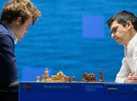 Anish Giri (right) held a draw against Magnus Carlsen (left) to maintain his half-point lead at the Tata Steel Masters. (Image: Jurriaan Hoefsmit/Tata Steel Chess Tournament 2021)