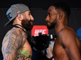 Michael Chiesa (left) and Neil Magny (right) will face off in the main event of Wednesday's UFC card on Fight Island. (Image: Getty)