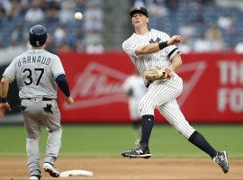 NY Yankees second baseman DJ LeMahieu turns a double play against the Tampa Rays at Yankees Stadium in the Bronx. The Yankees signed LeMahieu to a long-term deal through the end of the 2026 season. (Image: Kathy Willens/AP)