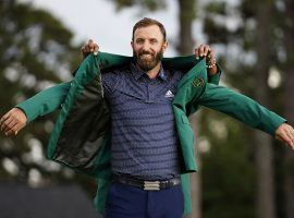 Dustin Johnson, seen here sliding on the winner's green jacket after a victory at the 2020 Masters in Augusta, Georgia, comes into the 2021 Masters as the consensus favorite. (Image: Matt Slocum/AP)