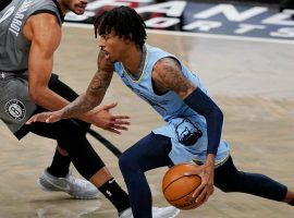Memphis Grizzlies point guard Ja Morant blows by defenders at Barclay's Arena in Brooklyn. (Image: Kathy Willens/AP)