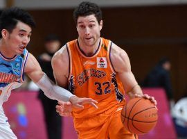Jimmer Fredette of the Shanghai Sharks drives the lane against the Sichuan Blue Whales during a night he dropped 70 points in the CBA in China. (Image: Xinhua/Sipa USA)