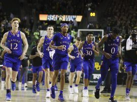 The disappointed Kansas Jayhawks leave the floor at the Ferrell Center in Waco, Texas after a loss to Baylor in Big 12 conference action. (Image: AP)