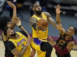 LA Lakers star LeBron James, seen here driving the lane against the Cleveland Cavs, put on a shooting clinic against his former team with a 46-point explosion. (Image: Tony Dejak/AP)