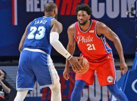 Joel Embiid of the Philadelphia 76ers defends LA Lakers star LeBron James at the Wells Fargo Center in Philadelphia. (Image: David Dow/Getty)