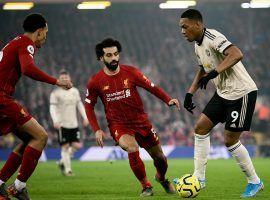 Liverpool hosts Man United in a battle for the top spot in the Premier League on Sunday. (Image: Ash Donelon/Manchester United/Getty)