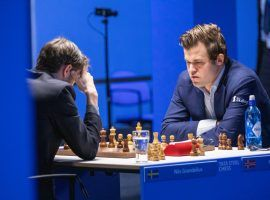 Magnus Carlsen broke through for his first win since Round 1 at the Tata Steel Masters on Tuesday, a victory that keeps his faint hopes of a title alive. (Image: Jurriaan Hoefsmit/Tata Steel Chess Tournament 2021)