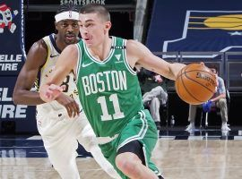 Boston Celtics rookie guard Payton Pritchard, seen here driving by the Indiana Pacers, will miss a couple of weeks with a knee injury. (Image: Ron Hoskins/Getty)