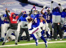 Buffalo Bills cornerback Taron Johnson, seen here running back an interception for a touchdown against the Baltimore Ravens, helped propel the Bills to a berth in the AFC title game for the first time in 27 years. (Image: Mark Konezny/USA Today Sports)