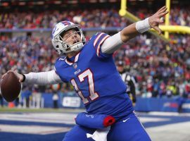 Josh Allen of the Buffalo Bills celebrates a touchdown. The Bills hold the #2 seed in the AFC and host the Indianapolis Colts in Wild Card weekend. (Image: Jeff T. Allen/AP)