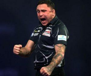 """Welshman and former professional rugby player Gerwyn Price celebrates victory Saturday afternoon at Alexandra Palace. Price has a shot at No. 1 in the world with a victory on Sunday as he readies to face two-time PDC world champion Gary """"The Flying Scotsman"""" Anderson. (image: Sky Sports)"""