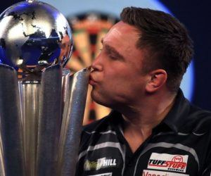 Welshman Gerwyn Price holds the fabled Sid Waddell Trophy Sunday as he defeated Scotsman Gary Anderson to capture the title and a No. 1 in the world ranking. The Premier Darts League season, originally set for February, is postponed till at least early April officials said Sunday in the wake of Price's victory.