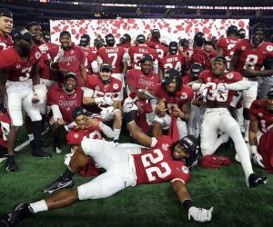 Alabama players pose after a decisive Rose Bowl victory over Notre Dame in the Rose Bowl Game (played in Arlington, Tx) on New Year's Day. The ratings for the CFP semifinal match were up by about 10 percent over last season. (Image: AP)