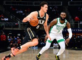Atlanta Hawks forward Danilo Gallinari, seen here defended by Jaylen Brown from the Boston Celtics, set a career and franchise record with 10 3-point shots. (Image: Suzanne Greenburg/Getty)