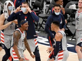 Bradley Beal and Russell Westbrook celebrate a comeback victory with the Washington Wizards over the Brooklyn Nets. (Image: AP)