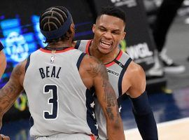 Bradley Beal and Russell Westbrook bump chests after Westbrook hit a big 3-pointer to cap off a fourth-quarter comeback for the Washington Wizards over the Brooklyn Nets. (Image: Donnie Becker)