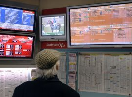 Would this punter at a British book subject himself to financial scrutiny? Under a proposed system of affordability checks, he may have no choice if he wants to keep wagering on races or sports. (Image: Reuters)