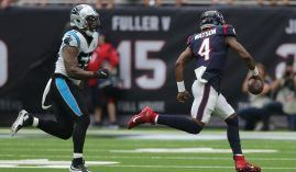 A Carolina Panthers defender pursues quarterback DeShaun Watson of the Houston Texans. (Image: Bob Levey/Getty)