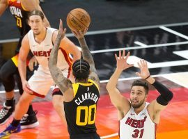 Utah Jazz guard Jordan Clarkson attempts a 3-pointer against the Miami Heat. The Jazz lost only one game since the first week of January. The red-hot Jazz covered the spread in seven-straight games. (Image: Lane Pryce/AP)