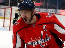 Alexander Ovechkin plays against the Flyers on Sunday, and one cross-sport prop bet asks whether he'll score more points than Tom Brady will throw touchdowns. (Image: Rob Carr/Getty)