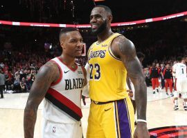 Portland Trail Blazers star Damian Lillard and LeBron James of the Los Angeles Lakers have a showdown in LA on Friday. (Image: Patrick Mahoney/Getty)