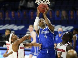 Drake forward ShanQuan Hemphill drives for a layup during a victory against Illinois State to keep their winning streak alive at 17-0. (Image: Charlie Neibergall/AP)