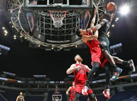 Minnesota Timberwolves rookie Anthony Edwards elevates for a dunk against Toronto Raptors forward Yuta Watanabe at the Target Center in Minneapolis, Minnesota. (Image: David Sherman/Getty)