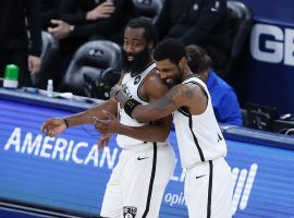 Kyrie Irving (right) hugs teammate James Harden after the Brooklyn Nets defeated the Oklahoma City Thunder in Oklahoma City. (Image: Alonzo Adams/USA Today Sports)